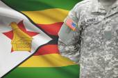 American soldier with flag on background - Zimbabwe — Stock Photo