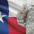 American soldier with US state flag on background - Texas — Stock Photo #63567901
