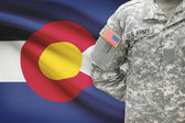 American soldier with US state flag on background - Colorado — Stock Photo