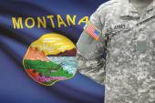 American soldier with US state flag on background - Montana — Stock Photo