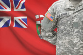 American soldier with Canadian province flag on background - Manitoba — Stock Photo