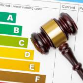 Wooden judge gavel over efficiency chart - studio shot — Stock Photo