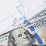 Hundred USA dollars banknote over stock market chart - studio shot — Stock Photo #64996461