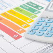 Colorful energy efficiency chart with calculator - studio shot — Stock Photo #64996619
