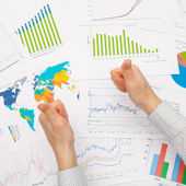 Business man and financial data - thumbs up — Stock Photo