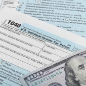 US Tax Form 1040 and 100 dollars — Stock Photo