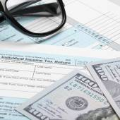 US Tax Form 1040 with 100 dollars and glasses — Stock Photo