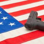 Handgun over US flag - studio  shoot — Stock Photo