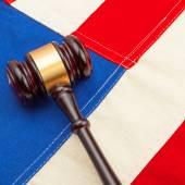 Wooden judge gavel over US flag — Stock Photo
