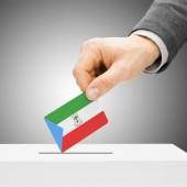 Voting concept - Male inserting flag into ballot box - Equatoria — Stock Photo