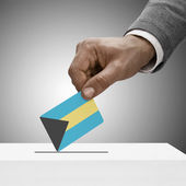 Black male holding flag. Voting concept - Bahamas — Stock Photo