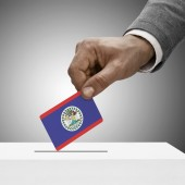 Black male holding flag. Voting concept - Belize — Stock Photo