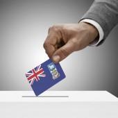 Black male holding flag. Voting concept - Falkland Islands — Stock Photo
