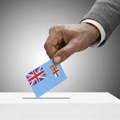 Black male holding flag. Voting concept - Fiji — Stock Photo