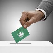 Black male holding flag. Voting concept - Macau — Stock Photo