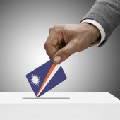 Black male holding flag. Voting concept - Marshall Islands — Stock Photo