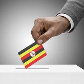 Black male holding flag. Voting concept - Uganda — Stock Photo