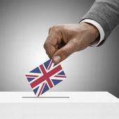 Black male holding flag. Voting concept - United Kingdom — Stock Photo