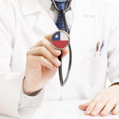 Doctor holding stethoscope with flag series - Chile — Stock Photo