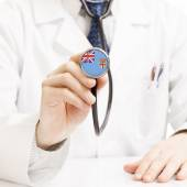 Doctor holding stethoscope with flag series - Fiji — Stock Photo