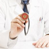 Doctor holding stethoscope with flag series - Montenegro — Stockfoto