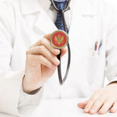 Doctor holding stethoscope with flag series - Montenegro — Stock fotografie