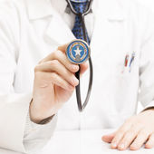 Doctor holding stethoscope with flag series - Commonwealth of th — Stock Photo