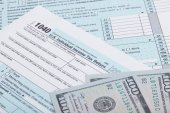 US Tax Form and dollars - studio shot — Stock Photo