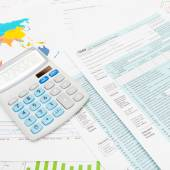 US 1040 Tax Form and calculator - studio shot — Stock Photo
