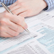 Taxpayer filling out 1040 Tax Form - studio shot — Stock Photo #68248287