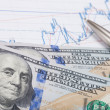Stock market graph with pen and hundred dollars banknote - studi — Stock Photo #68248313