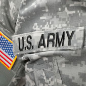 US Army and flag patch on solder's uniform — Stock Photo