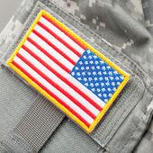 US flag shoulder patch on solder's uniform - studio shot — Stock Photo