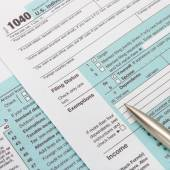 US 1040 Tax Form and silver ball pen — Stock Photo