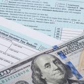 US 1040 Tax Form and dollars - studio shot — Stock Photo