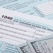 US 1040 Tax Form and dollars — Stock Photo
