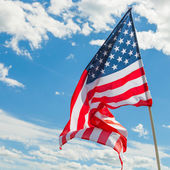 USA flag with clouds on background - outdoors shoot — Stock Photo