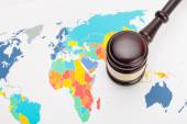 Wooden judge's gavel and over world map — Stock Photo