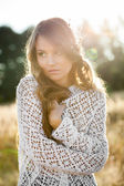 Portrait of a beautiful young lady model in field at sunset — Stock Photo