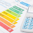 Colorful energy efficiency chart and calculator - close up shot — Stock Photo #69537493