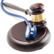 Judge gavel and stethoscope next to it - close up shot — Stock Photo #69537577