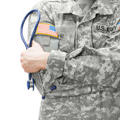 US Army doctor holding stethoscope next to his shoulder - studio shot — Stock Photo