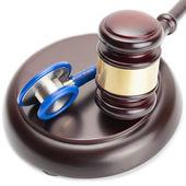 Judge gavel and stethoscope near it - close up shot — Stock Photo