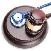 Judge gavel and stethoscope on white - close up shot — Stock Photo