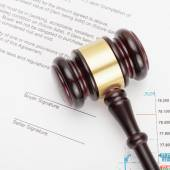Wooden judge's gavel over unsigned contract - close up shot — Stock Photo
