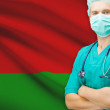 Surgeon with national flag on background series - Belarus — Stock Photo #70743547