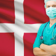 Surgeon with national flag on background series - Denmark — Stock Photo #70743683