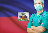 Surgeon with national flag on background series - Haiti — Stock Photo