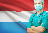 Surgeon with national flag on background series - Luxembourg — Zdjęcie stockowe