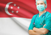 Surgeon with national flag on background series - Singapore — Stock Photo